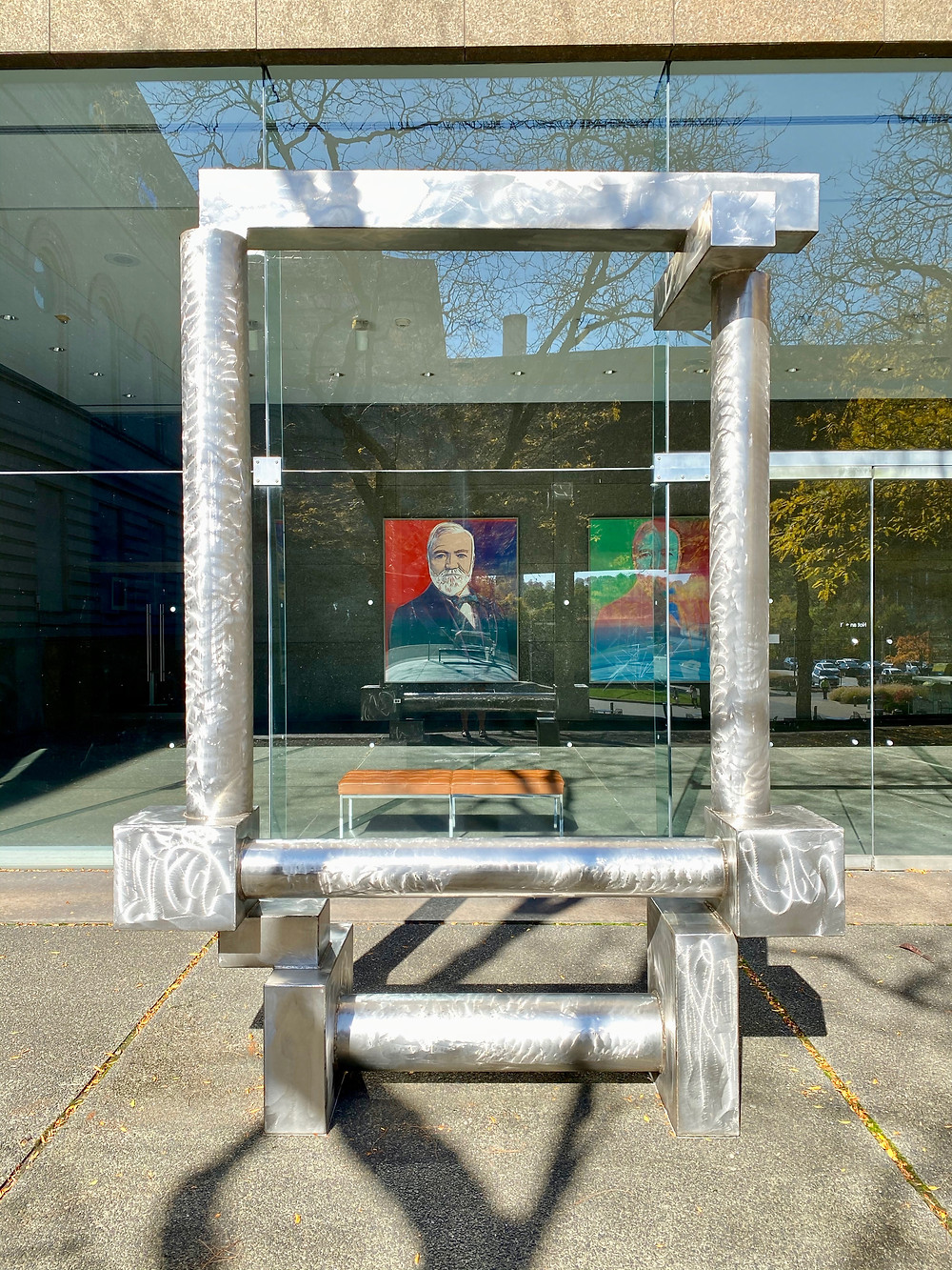 David Smith, Cubi XXIV, 1964, framing Andy Warhol's portraits of Carnegie