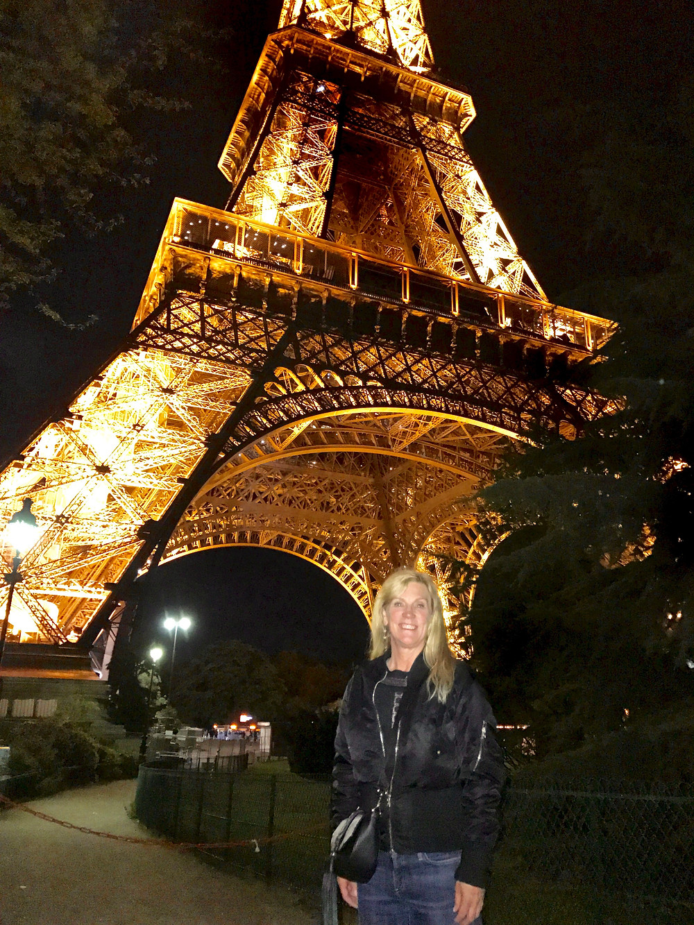 me enjoying the Eiffel Tower at night  before the glass wall was installed