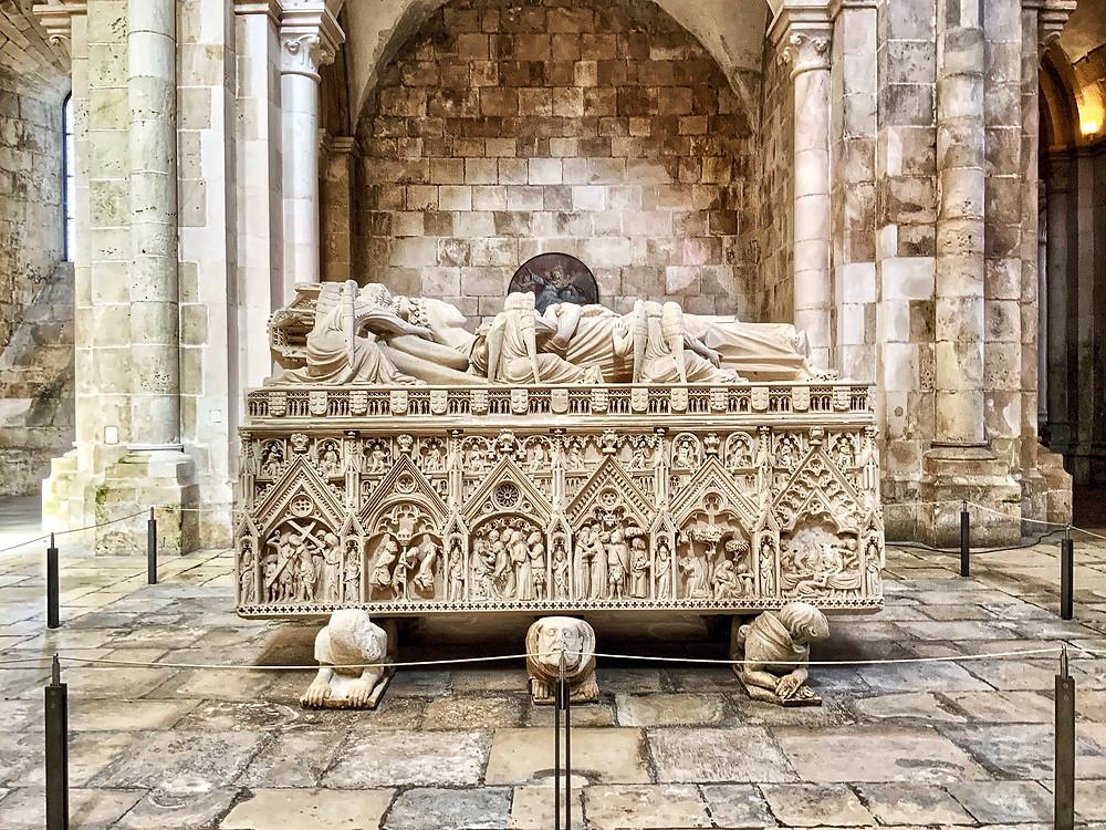the ornate tomb of Inês de Castro in Alcobaça Monastery