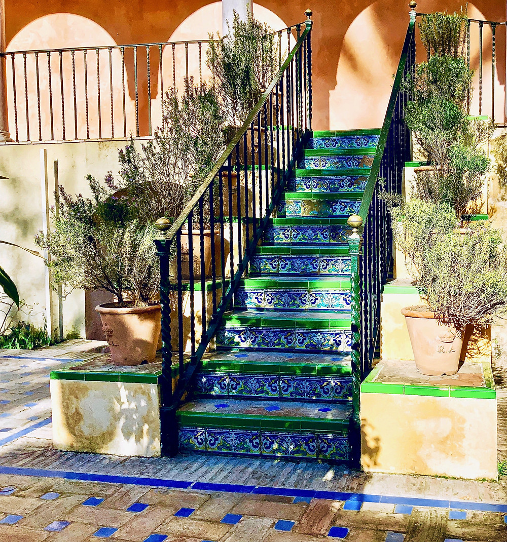 a beautiful staircase in the Alcazar Gardens