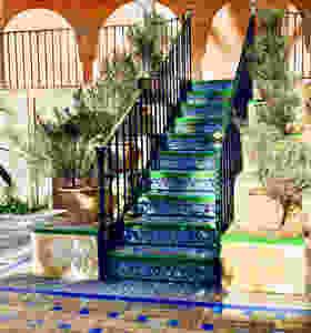 a beautiful staircase in the Alcazar Gardens