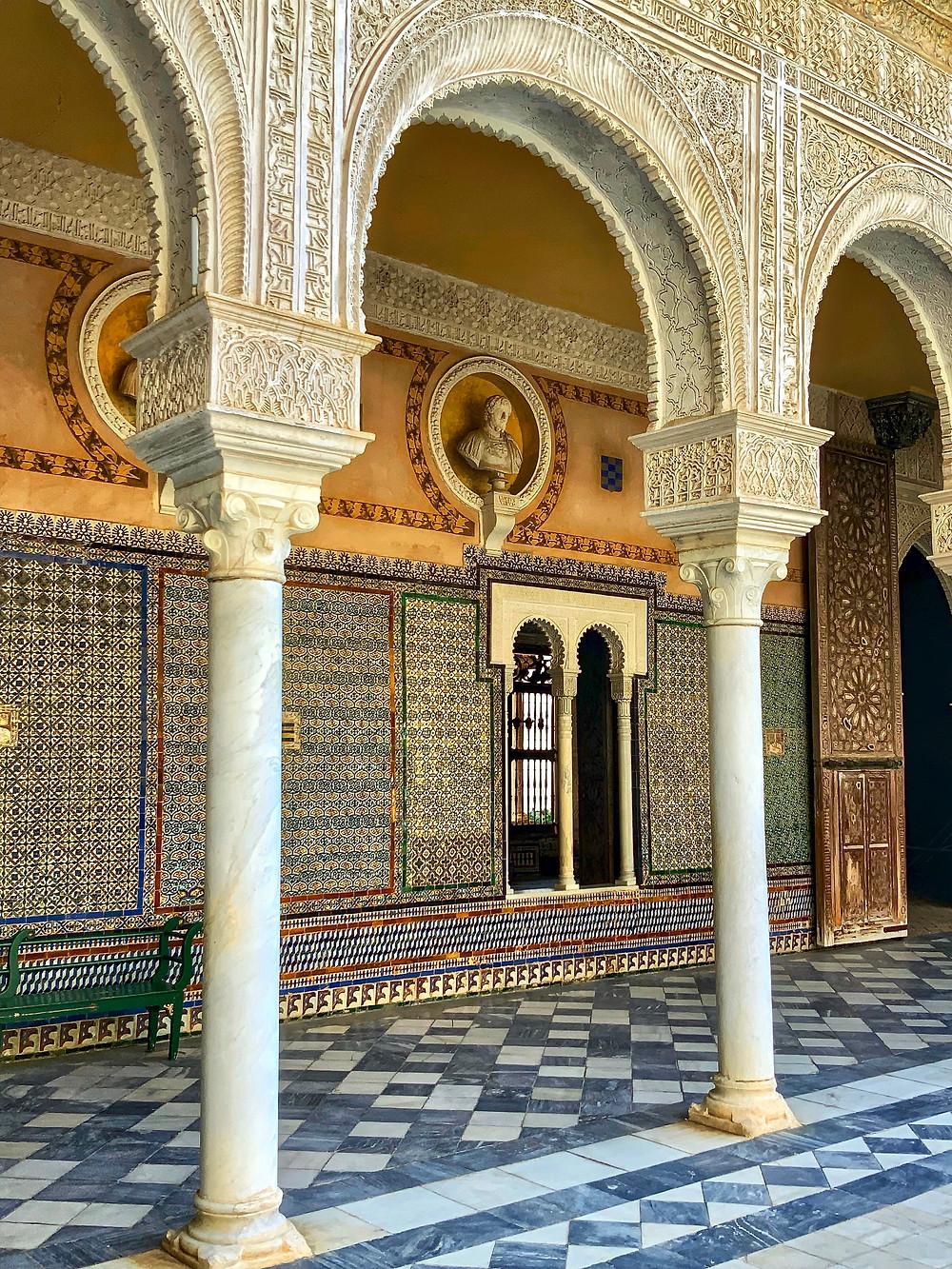 Mudejar arches and azulejo tiles in the courtyard of Casa de Pilatos