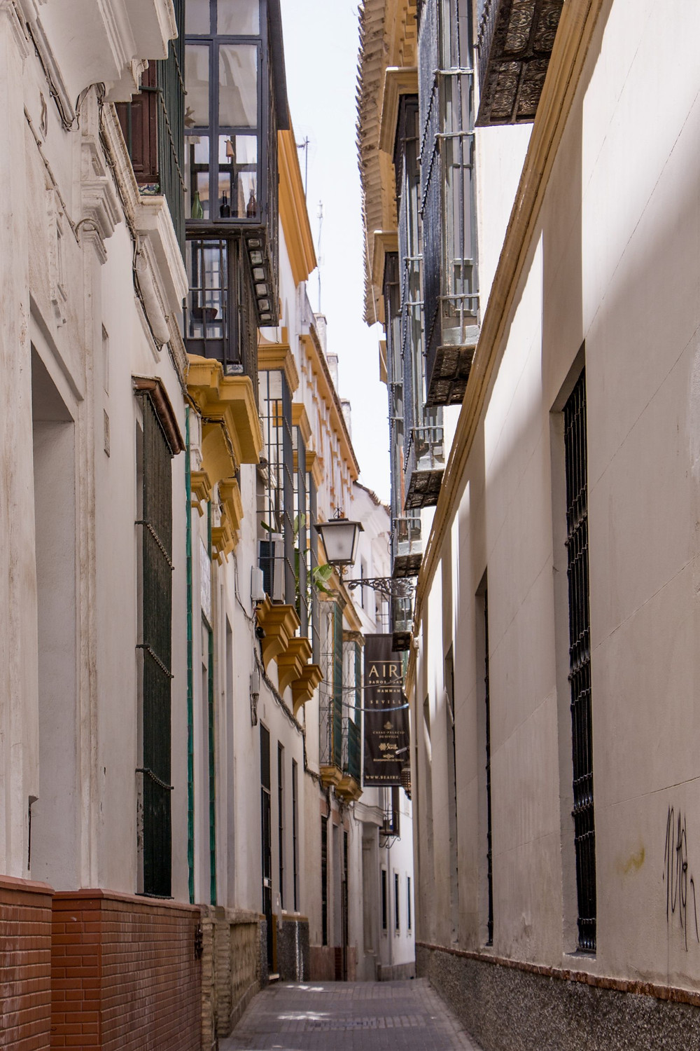 "a tiny narrow ""kissing street"" in Barrio Santa Cruz"