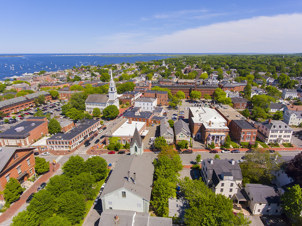 Newburyport historic downtown including State Street and First Religious Society Unitarian Universalist Church with Merrimack River at the background