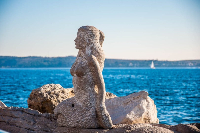a mermaid on Piran's waterfront -- artists have been invited to chisel the seaside stone