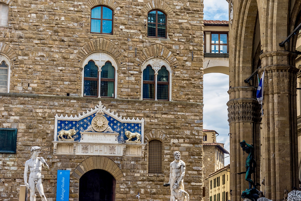 entrance to the Palazzo Vecchio with a copy of Michelangelo's David on the left