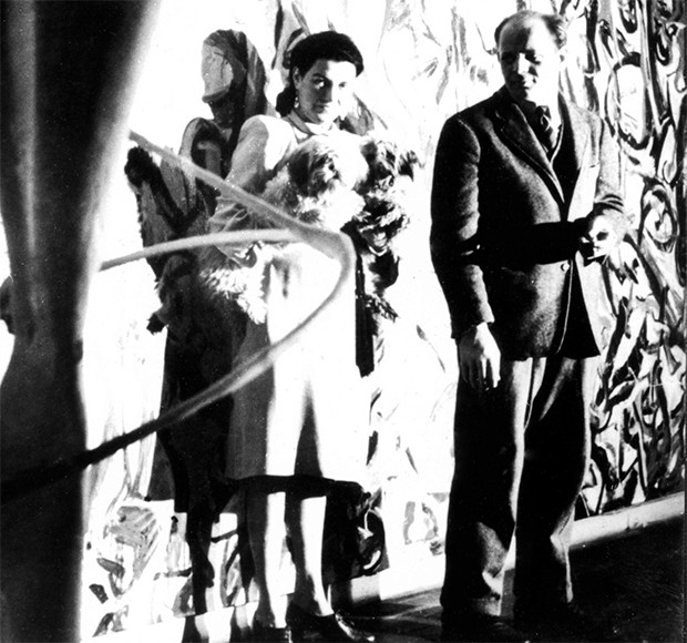 Peggy and Jackson Pollock in front of Mural, 1943, a massive 160 square foot painting he made for Peggy's townhouse. Peggy later donated it to the University of Iowa when she moved to Venice