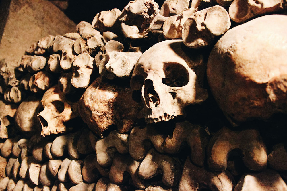 creepy skulls in the Catacombs in Paris