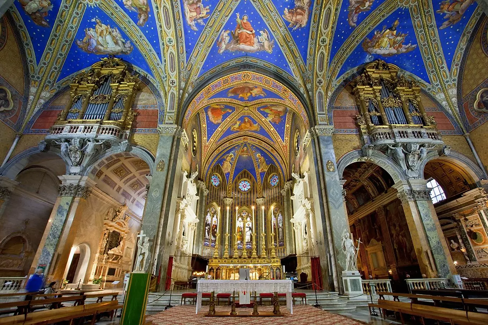 the blue vaulted Gothic nave