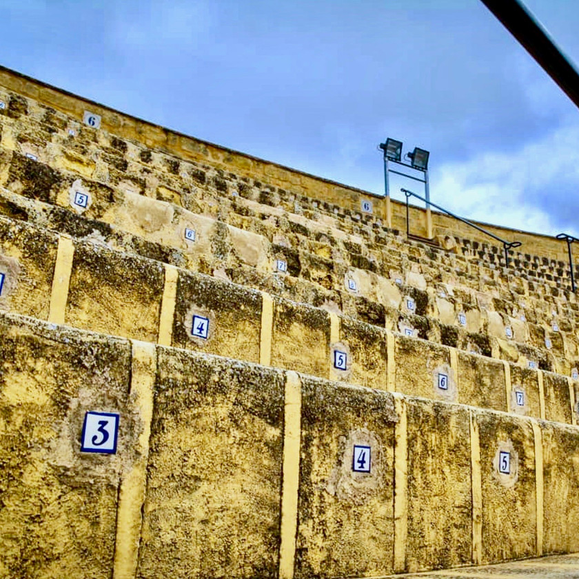 the numbered seats in the Plaza de Toros, a bullring in Osuna Spain