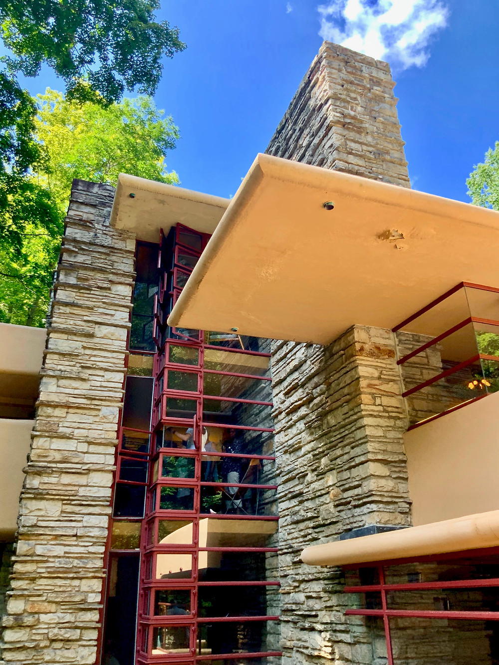 the cornerless windows, in Cherokee Red, on the second and third floor of Fallingwater
