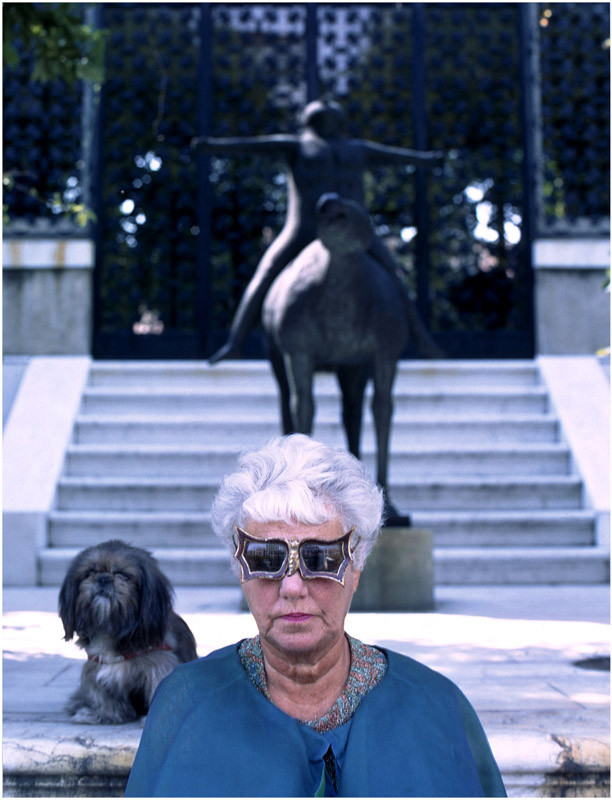 Peggy Guggenheim in Venice. Her Marino Marini sculpture in the background. Her palace in Venice is now the Peggy Guggenheim Collection.