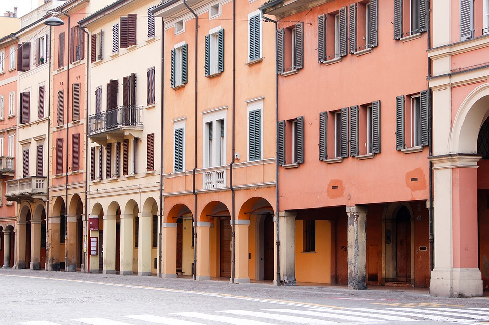 beautiful pastel houses in historic Bologna