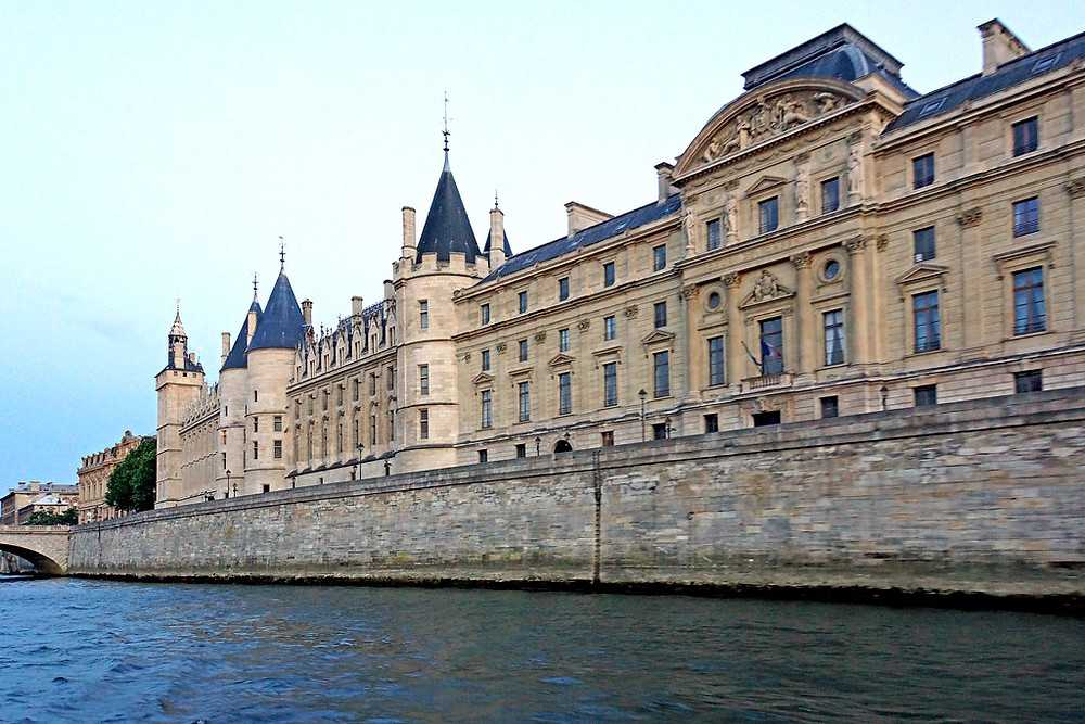 the imposing Conciergerie on the banks of the Seine