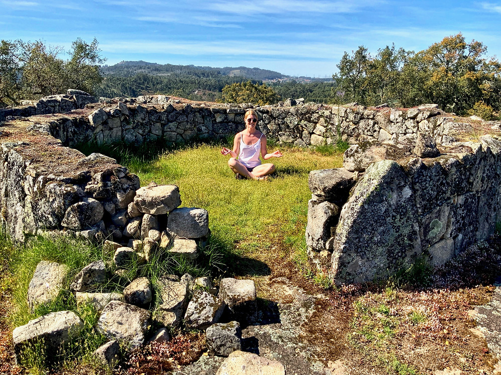 my daughter relaxing inside one of the excavated stone huts
