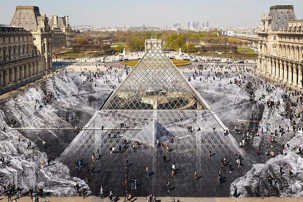 April 2019 artist JR installation at the Louvre, which by illusions shows the I.M. Pei Pyramid in a crater.