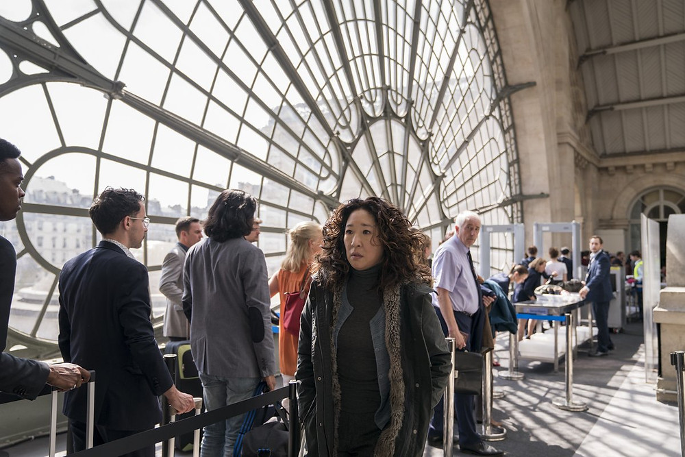 Eve at Paris' Gare du Nord, desperate to get back to London after stabbing Villanelle
