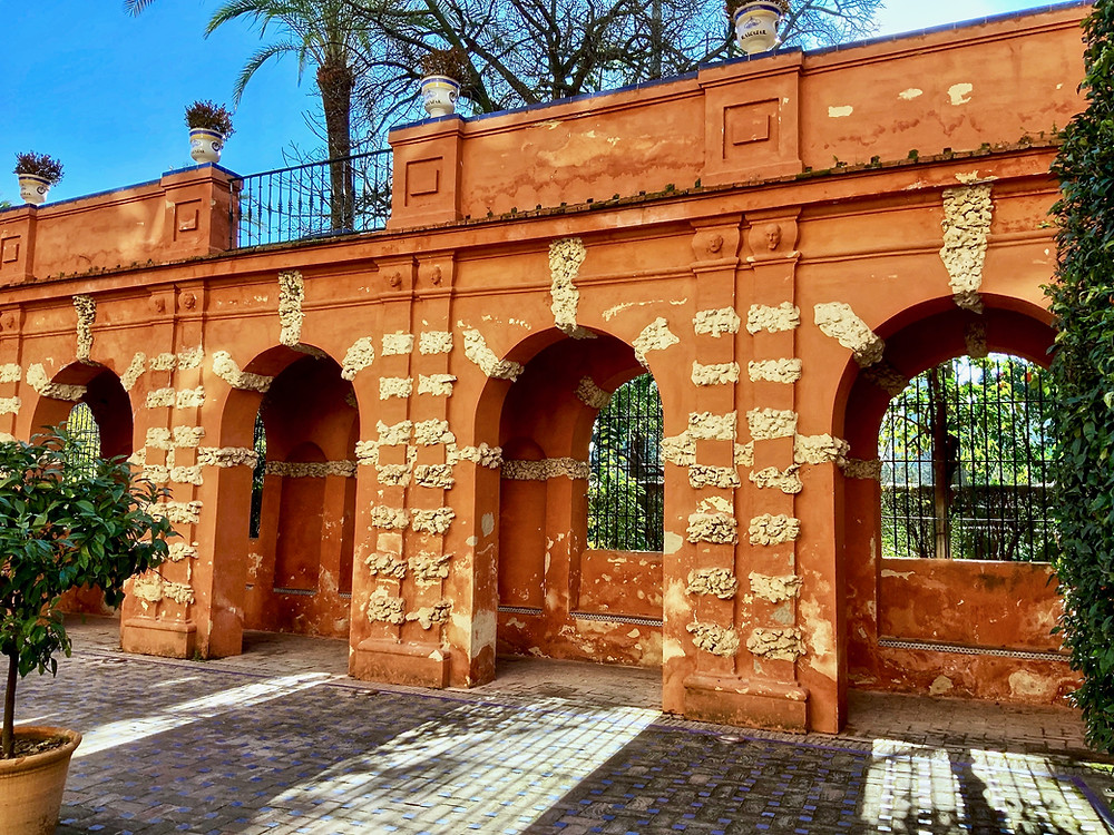 orange grotto walls in the Alcazar Gardens in Seville
