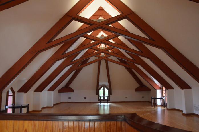 the second floor of Gaudí's El Capricho with an artesonado ceiling of interlaced beams