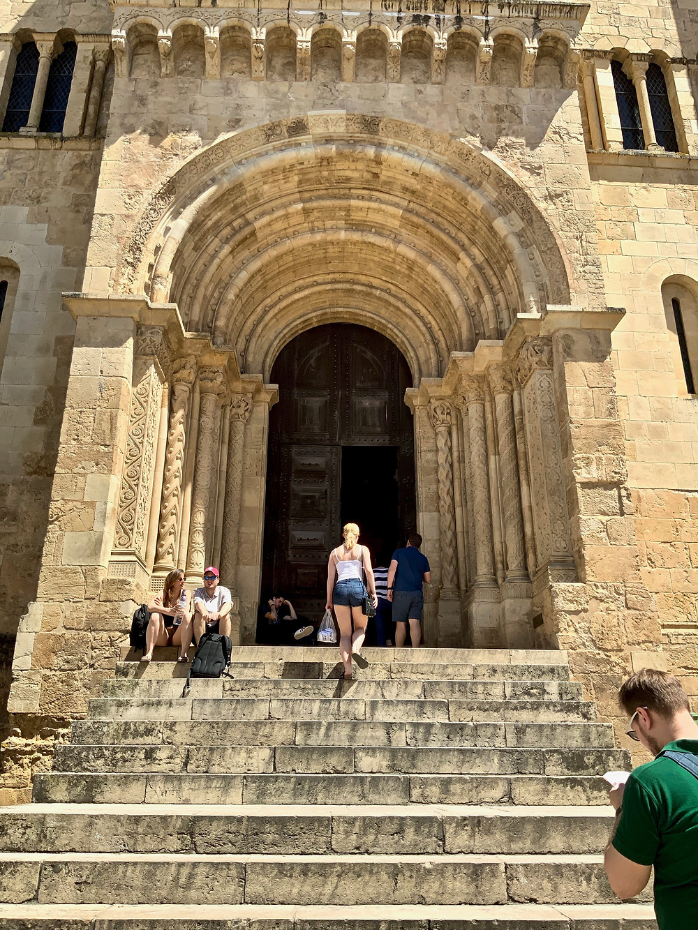 my daughter heading up the steps of Coimbra's Old Cathedral