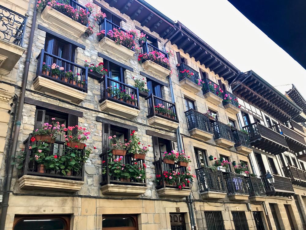 flower bedecked balconies in Hondaribbia Spain