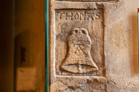 Graffiti depicting the name 'Thomas' above a bell with an 'A' on the side still survives in the upper chamber of the Beauchamp Tower.