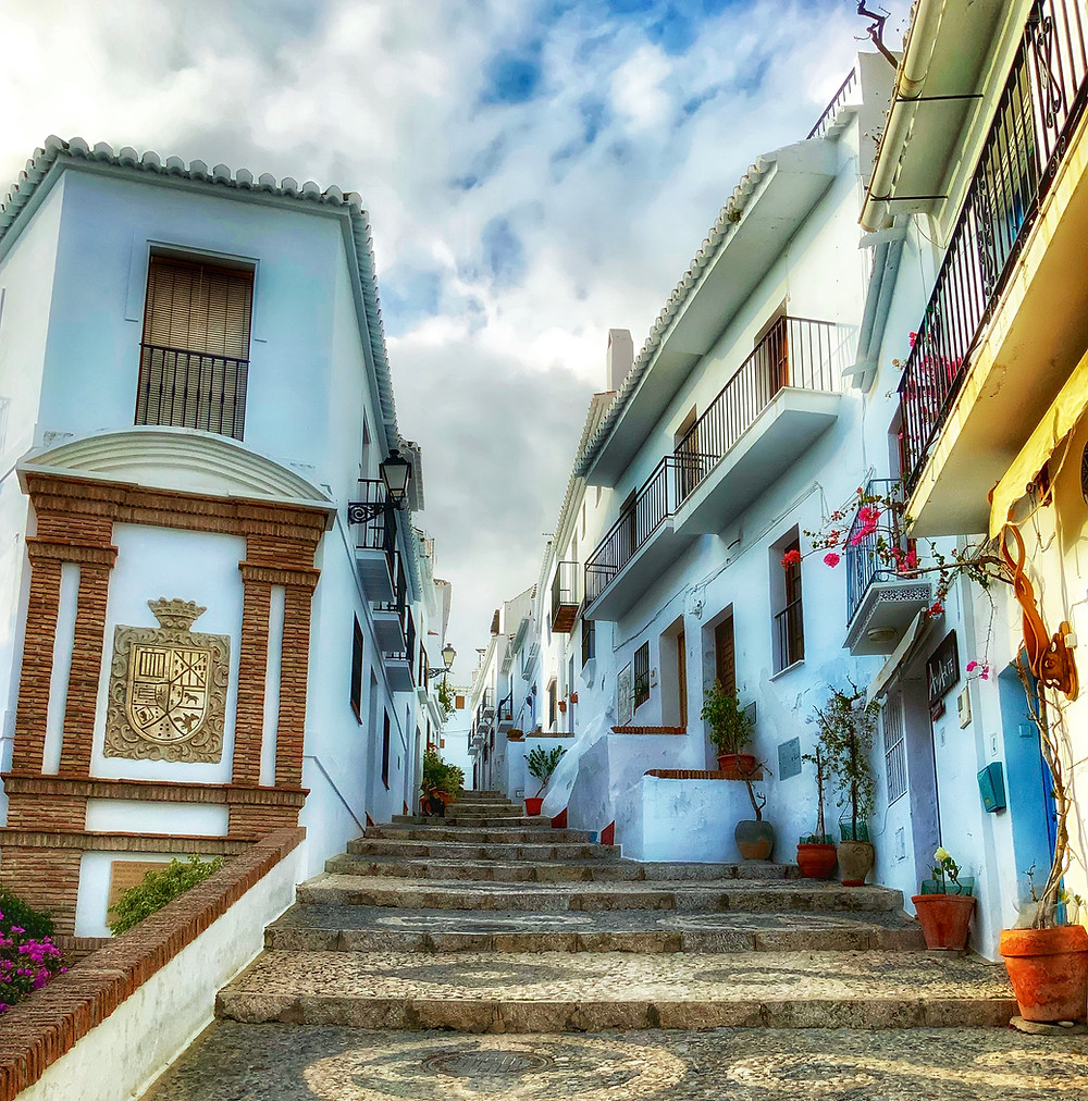 the main cobbled pathway through Frigiliana Spain