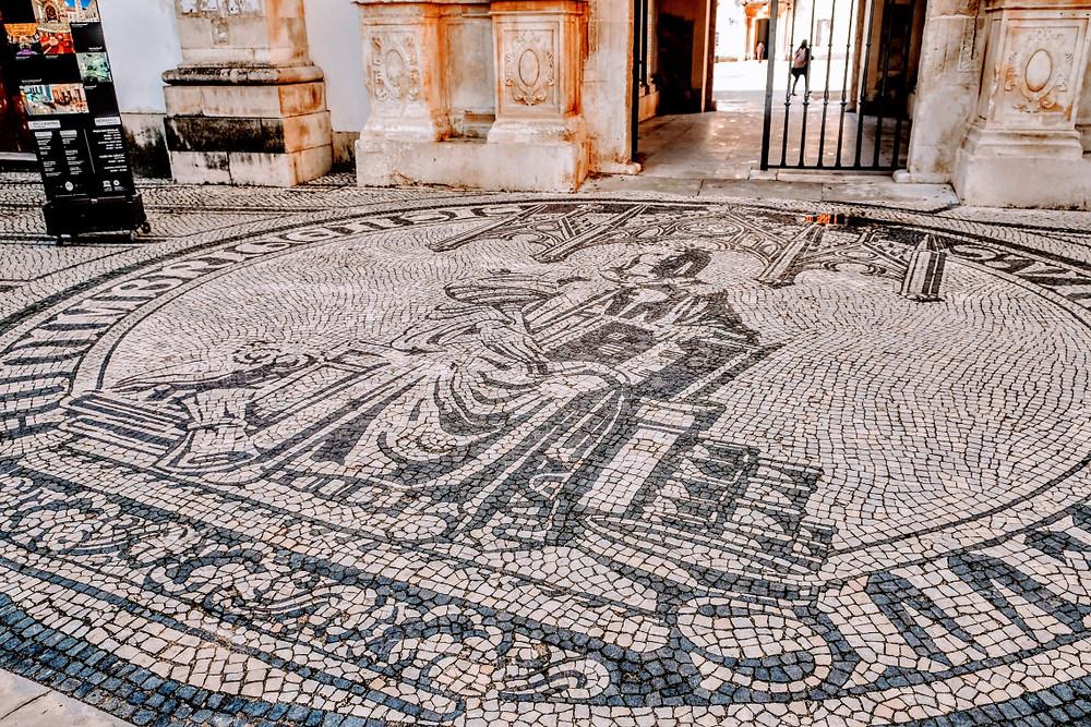 Minerva mosaic in front of the Porta Ferrea.  Minerva is the Roman goddess of wisdom.