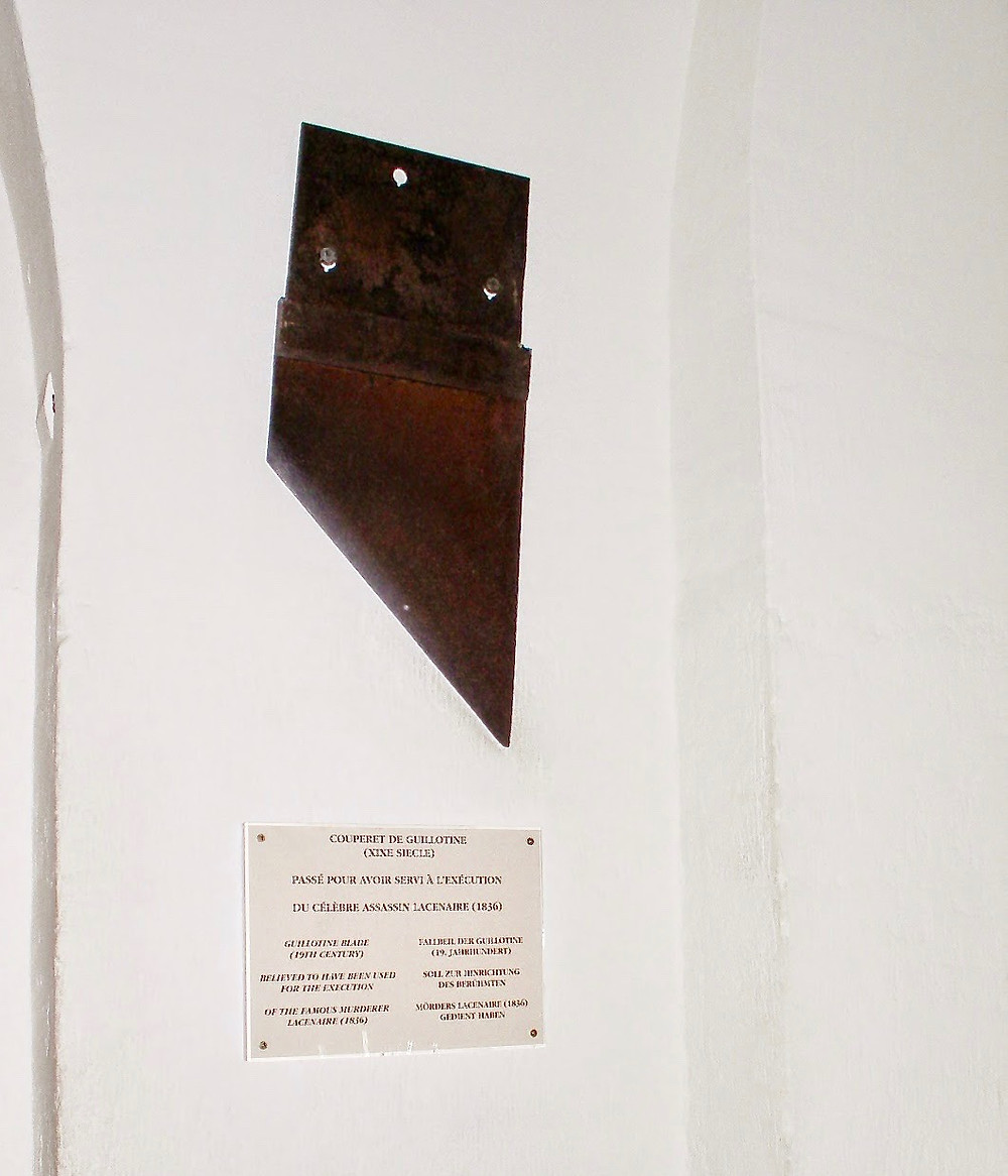 an actual guillotine on display at the Conciergerie