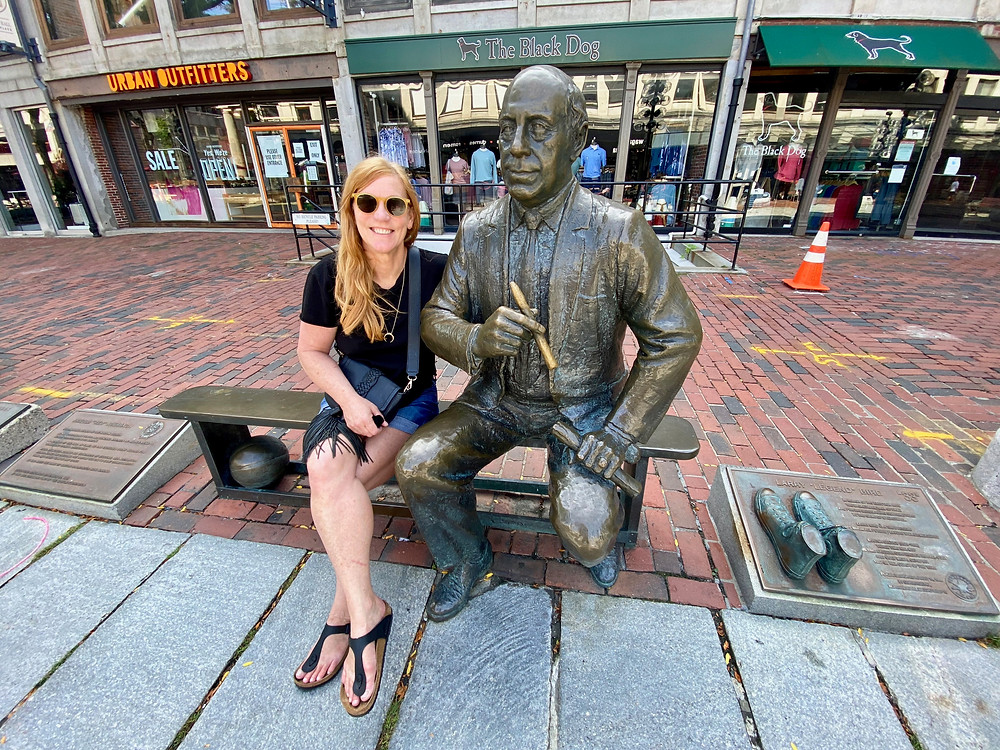 me with the Red Auerbach statue outside Quincy market at Faneuil Hall