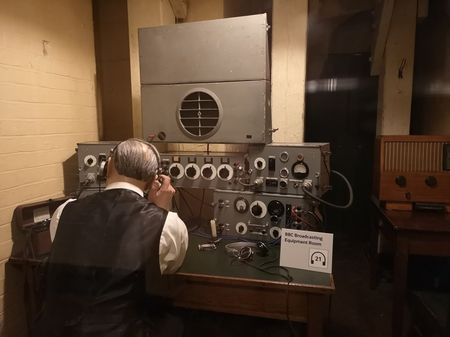 a wax mannakin seated behind the controls in the BBC broadcasting room in the cabinet war rooms. Churchill made 4 broadcasts from the bunker.