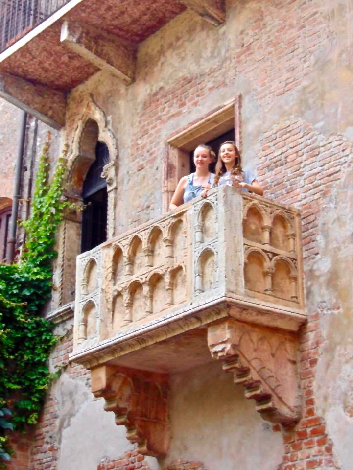 my daughter Gillian and her friend on Juliet's balcony in Verona
