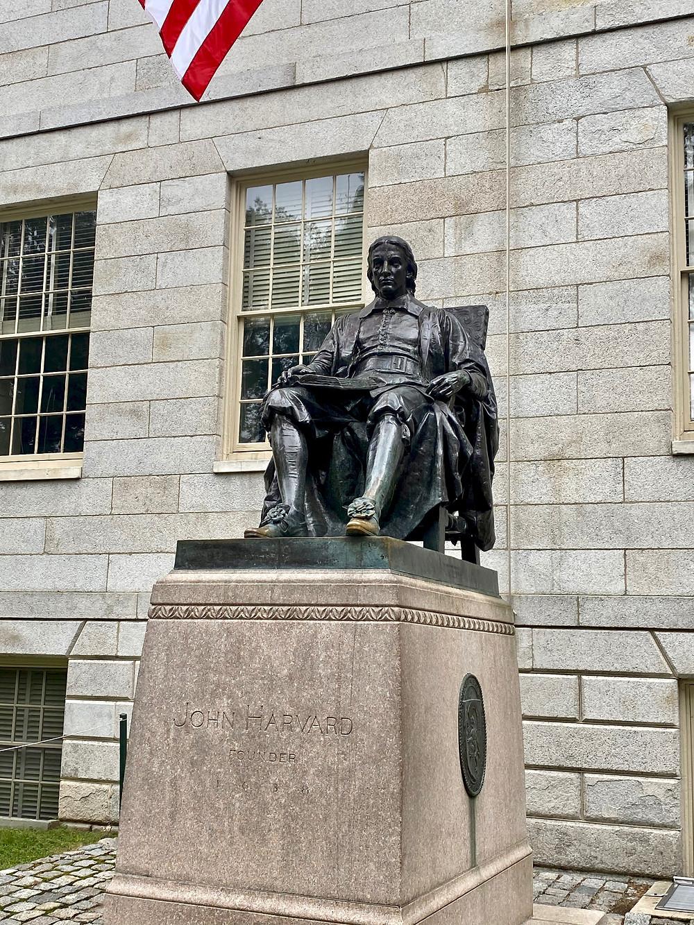 statue of John Harvard in Harvard Yard