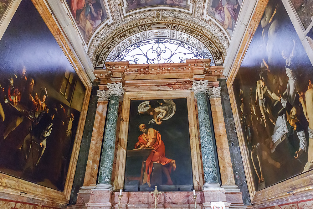 Caravaggio's triptych about the life of St. Matthew in the Contarelli Chapel