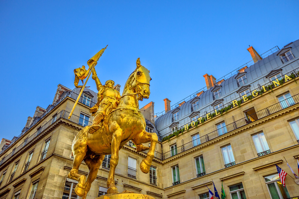 golden equestrian sculpture of Joan of Arc by Emmanuel Fremiet in the square of Louvre Museum Palace