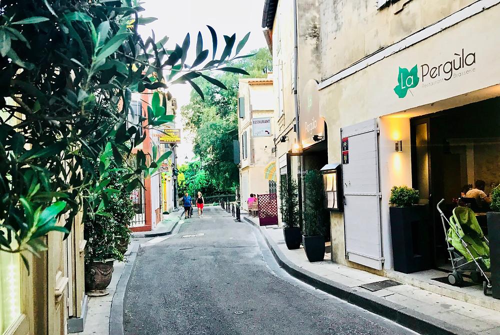 Rue Porte-de-Laure in Arles, a restaurant lined street near the Roman Amphitheater