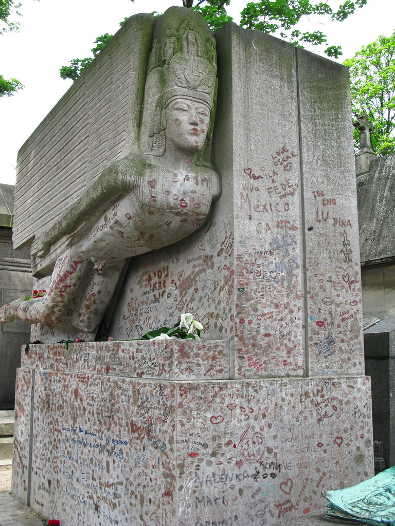 Oscar Wilde's tomb at Pere Lachaise Cemetery in Paris, covered with lipstick kisses from his superfans