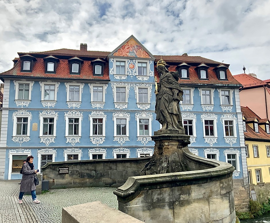 "The storybook ""Wedgewood"" house in Bamberg. It's painted in blue with intricate white stucco designs. The house was the birthplace of Joseph Heller, a local businessman, historian and art collector."