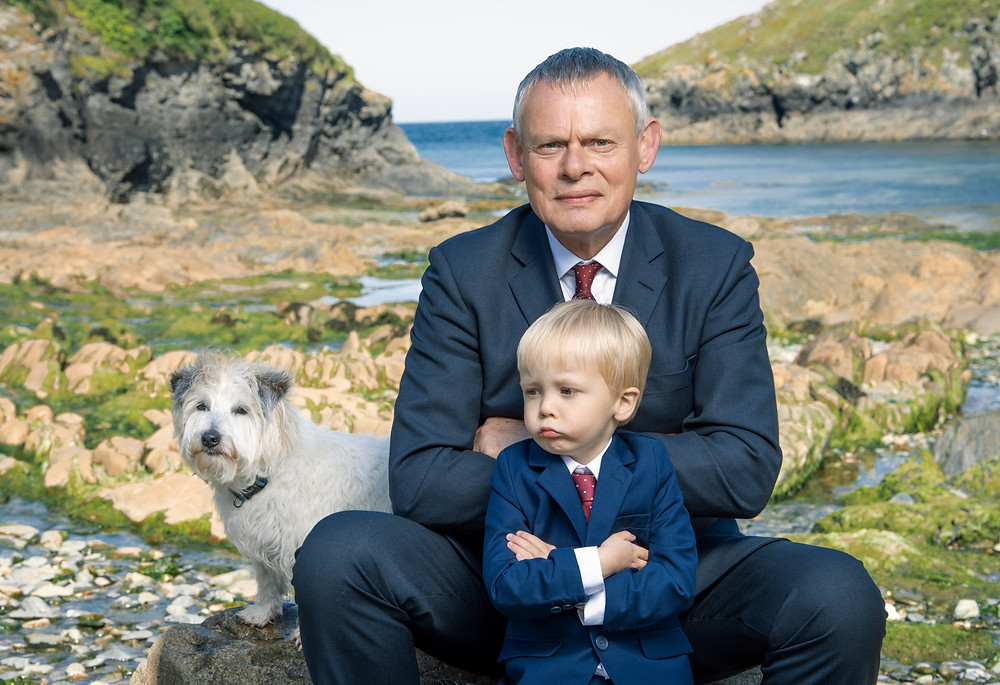 Doc Martin, his son James, and the dog he grudgingly lives with for Louisa's sake