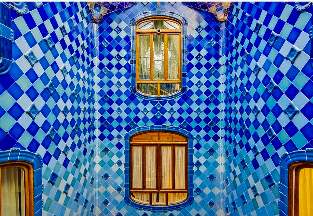 the blue tiled courtyard and atrium of Casa Batllo