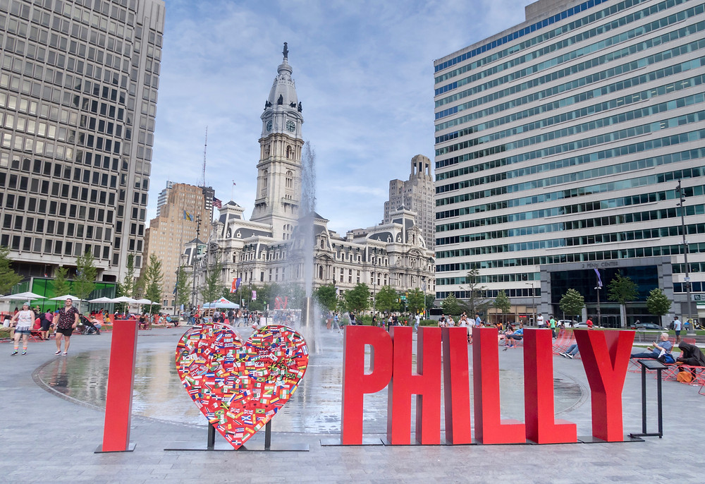 the I heart Philly sign with City Hall in the background