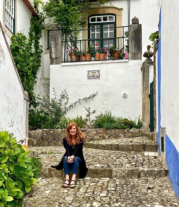 hanging out on a cobbled pedestrian street in Óbidos