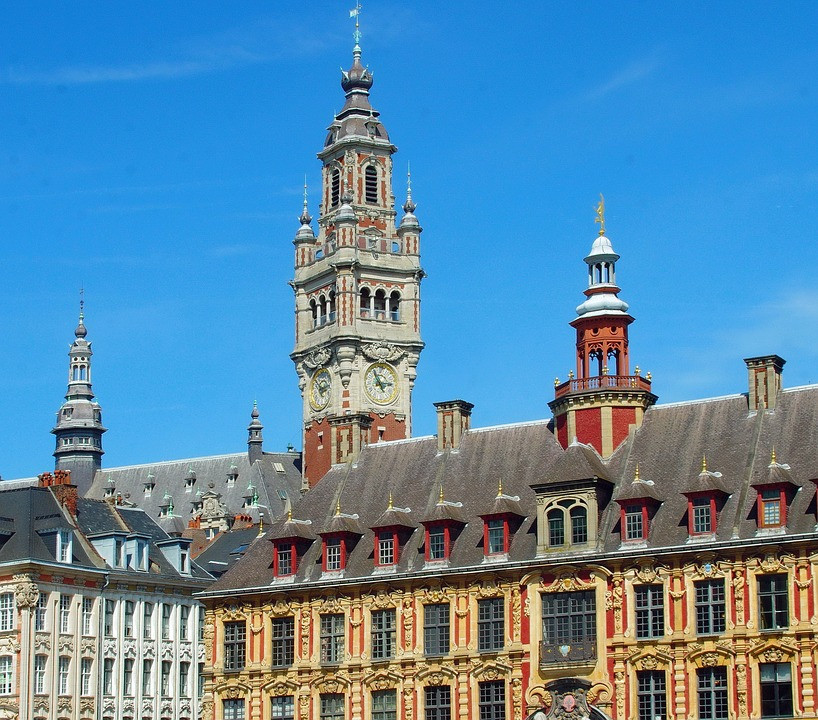 Old Stock Exchange and the Belfry in Lille France. You can climb to the top of the Belfry at 104 meters to get a panoramic view of the city.