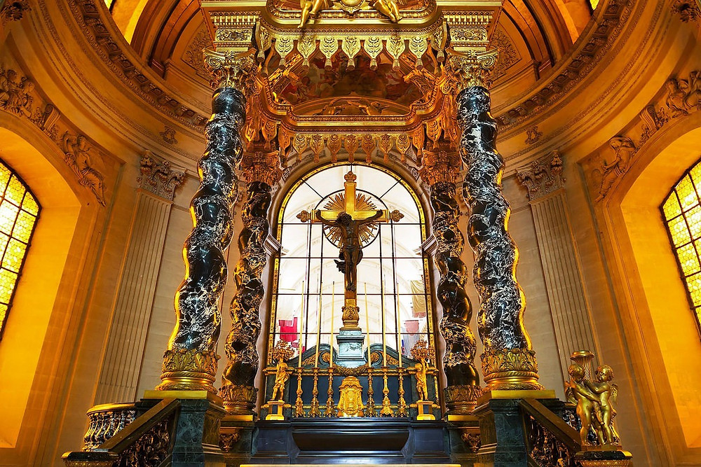 the garish high altar of the royal chapel in Les Invalides