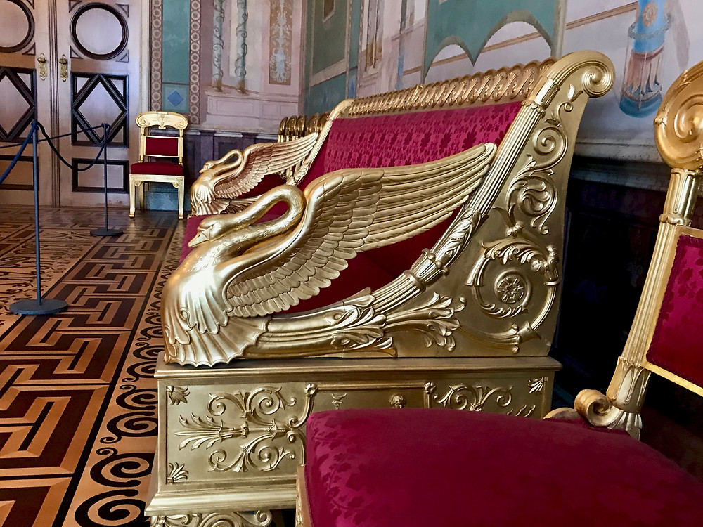 an adorable little swan motif on a couch in the Stone Rooms of the Munich Residenz