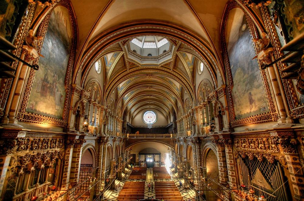 interior of Montserrat basilica, renovated by Modernist architect Josep Puig i Cadafalch