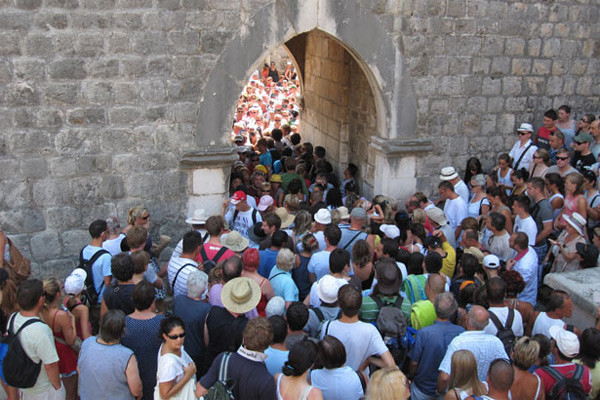 Tourists from cruise ships crowd Pile Gate in Dubrovnik