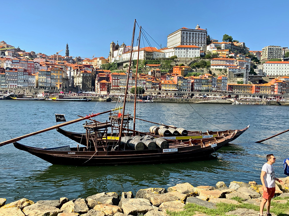 a rabelo boat loaded with caskets of port on the Douro River