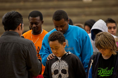 Skate Icon Christian Hosoi praying for attendees