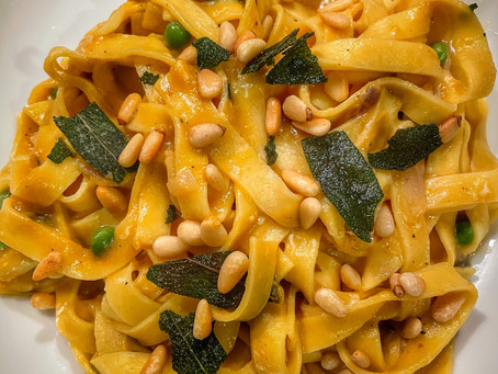 Fettuccine In a Pumpkin Cream Sauce with Peas, Toasted Pine Nuts and Sage